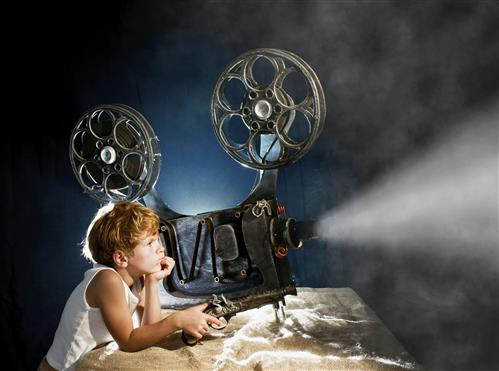 girl watches projector reel